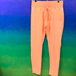 fp movement • orange sunny skinny sweatpants m